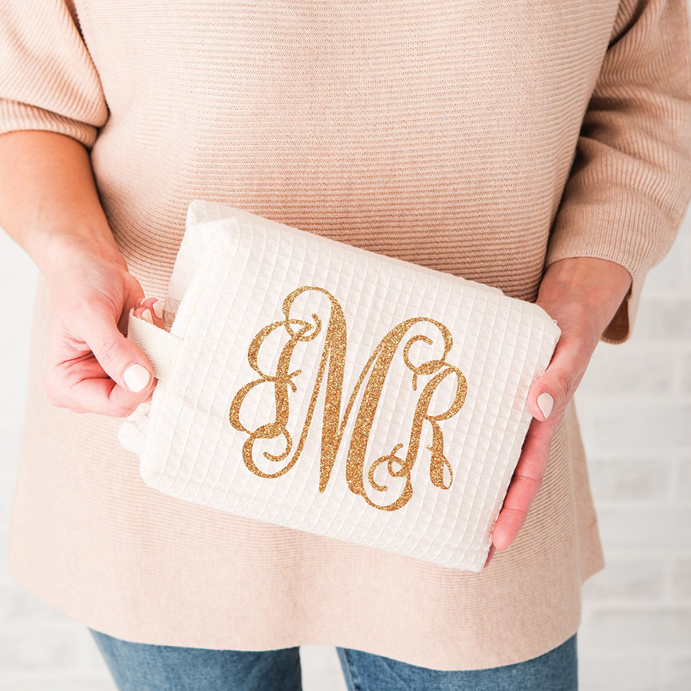 3-Letter Script Monogram embroidered in gold on the Ivory Waffle Weave Cosmetic Bag.