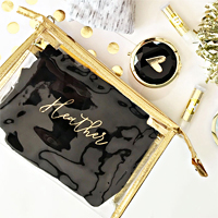 Custom clear see-through cosmetic bags are an on trend way to package bridesmaids gifts for your favorite ladies.  Personalized with a script name or single initial in metallic gold foil.  These cosmetic bags will be their go-to travel bag.