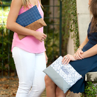 Women carrying the Ella Grey and Charlie Dot Zipper Pouches