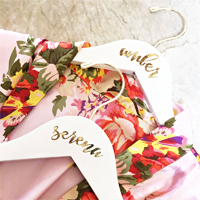 Personalized hardwood flower girl hangers are a great gift for the little girl in your bridal party to help her feel like one of the big girls. Pair with her adorable dress or a child sized floral satin bridal robe as a custom gift idea she will cherish.