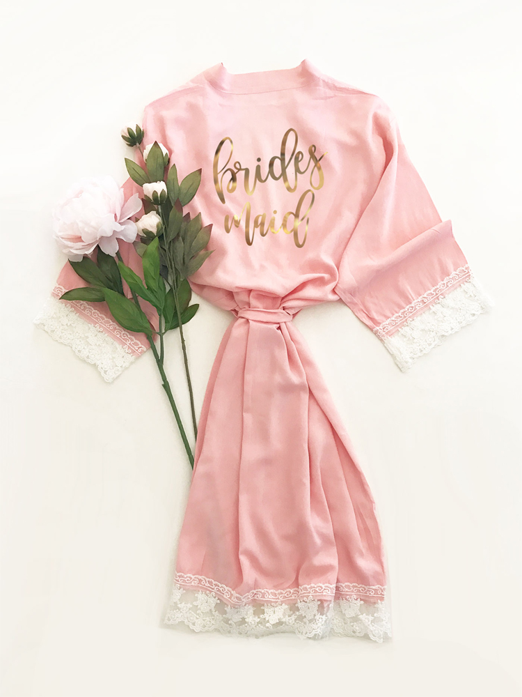 Made of soft cotton rayon, these delicate cotton lace robes feature the member of your bridal party's title in a pretty script gold foil on the back.  Your ladies will love wearing these robes while getting ready for your wedding.