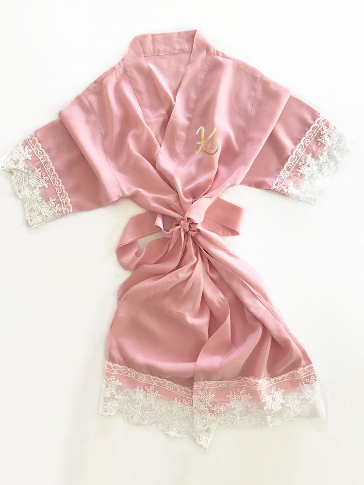 Your little flower girl with be pretty in pink dressed in this delicate, cotton lace monogram bridal robe.  A must-have for wedding day photos of you and your bridal party.