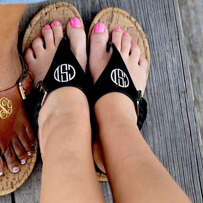 Woman wearing her personalized black faux leather everyday sandals