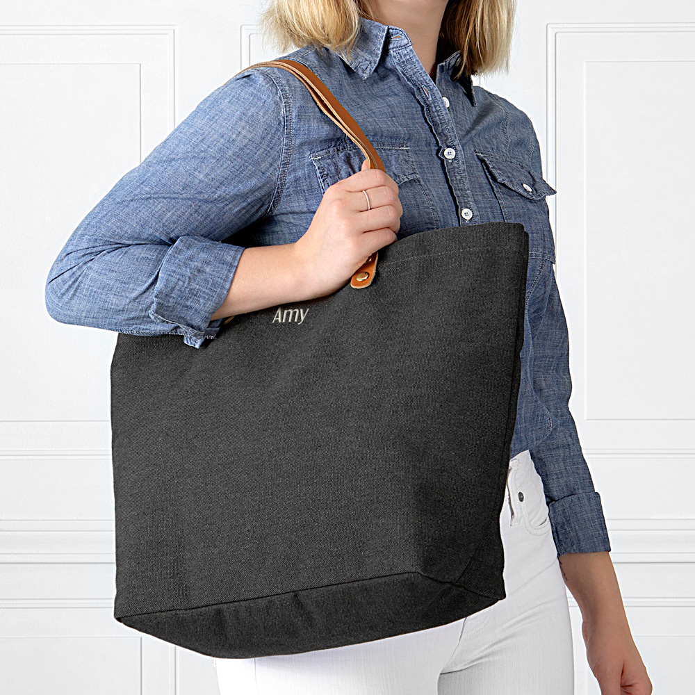 Black washed canvas tote bag personalized with custom embroidered name