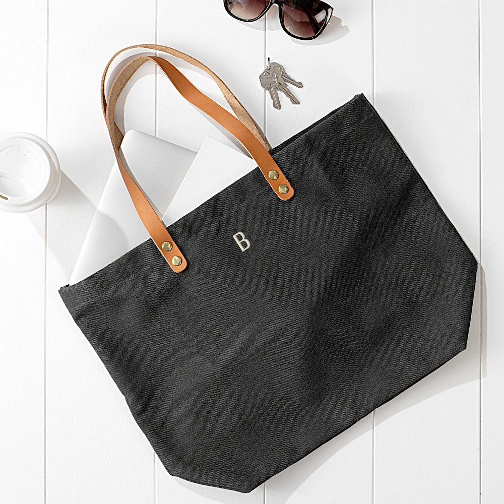 Black washed canvas tote bags personalized with custom embroidered single initial