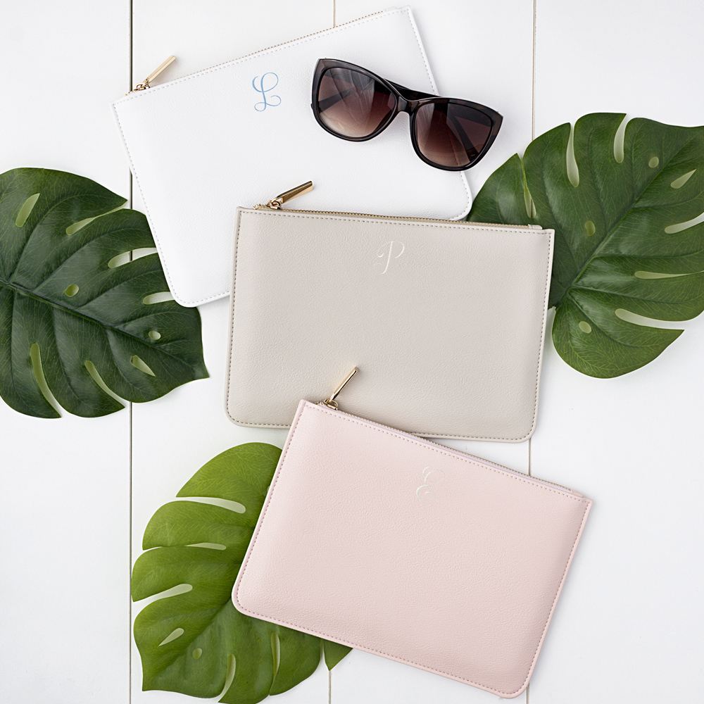 Pink, White, and Gray vegan leather clutches with single embroidered initials