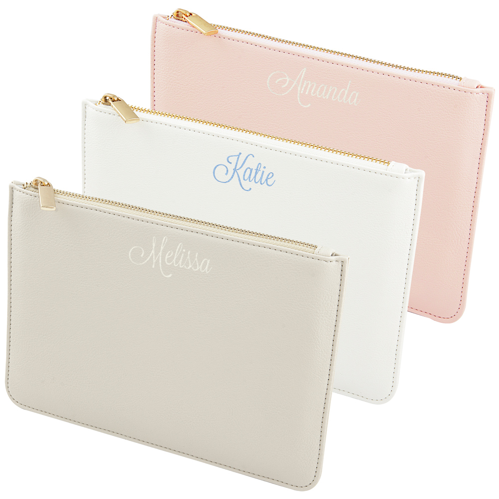 Pink, White, and Gray vegan leather clutches with metal zippers