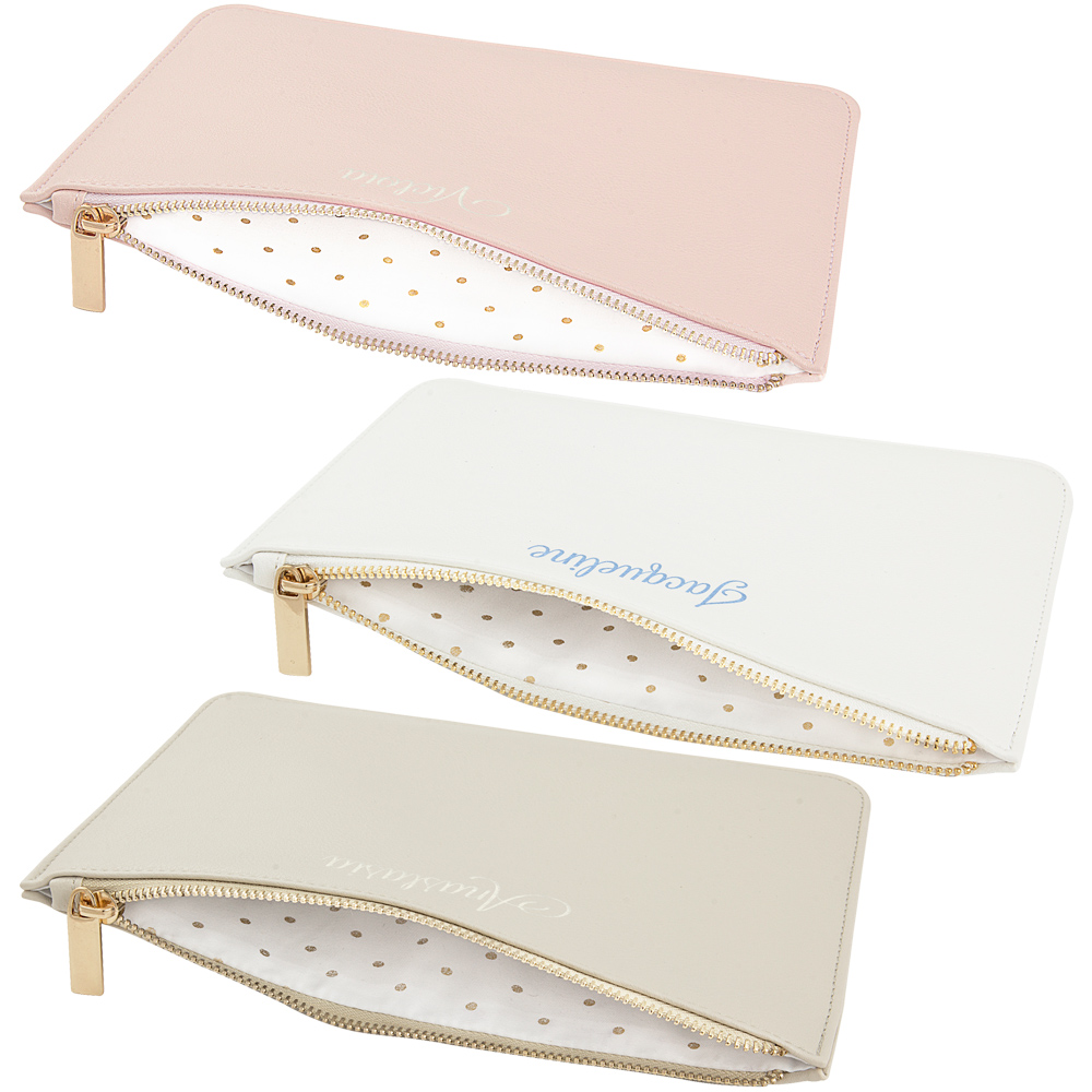 Pink, White, and Gray vegan leather clutches with embroidered names, open to reveal polka-dot interior lining