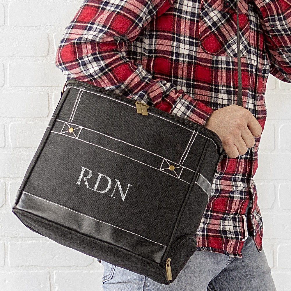 Man carrying personalized black canvas insulated 16 can soft sided dispenser cooler with over-the-shoulder-strap