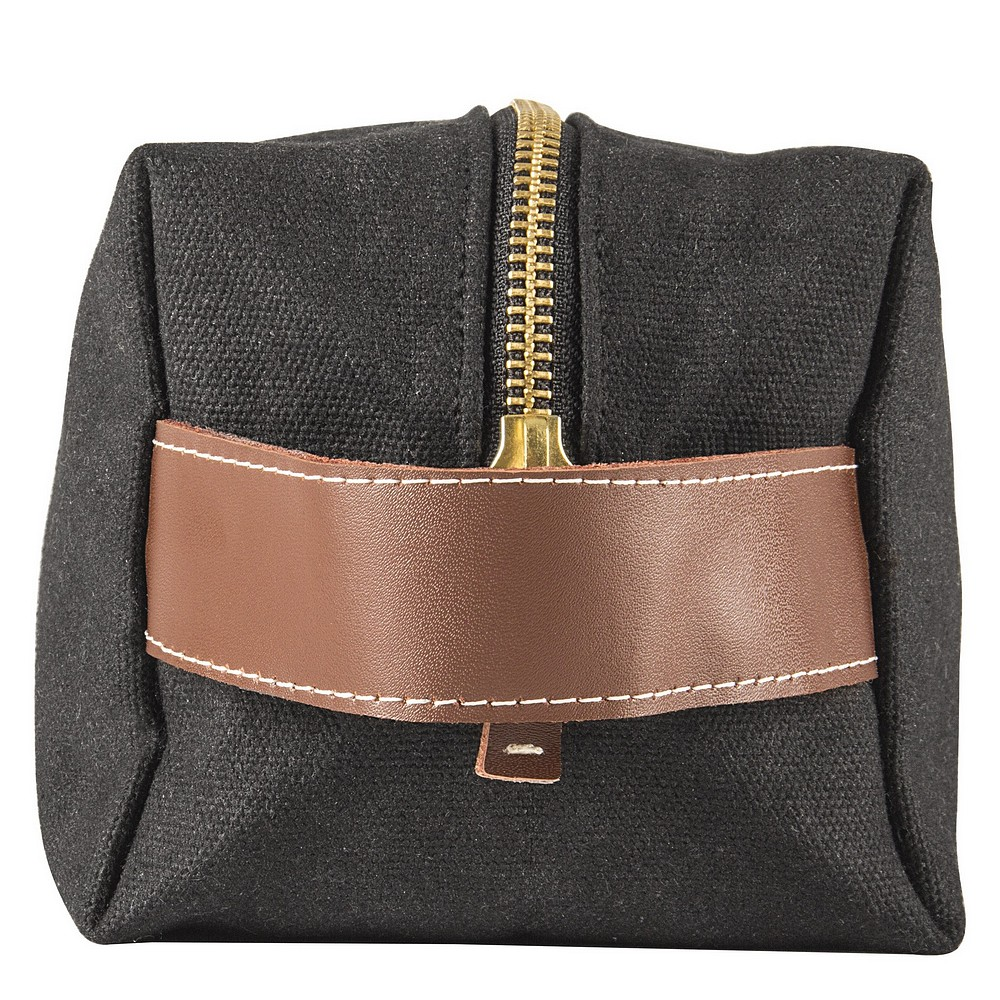 Faux leather carry handle on side of personalized canvas dopp bag