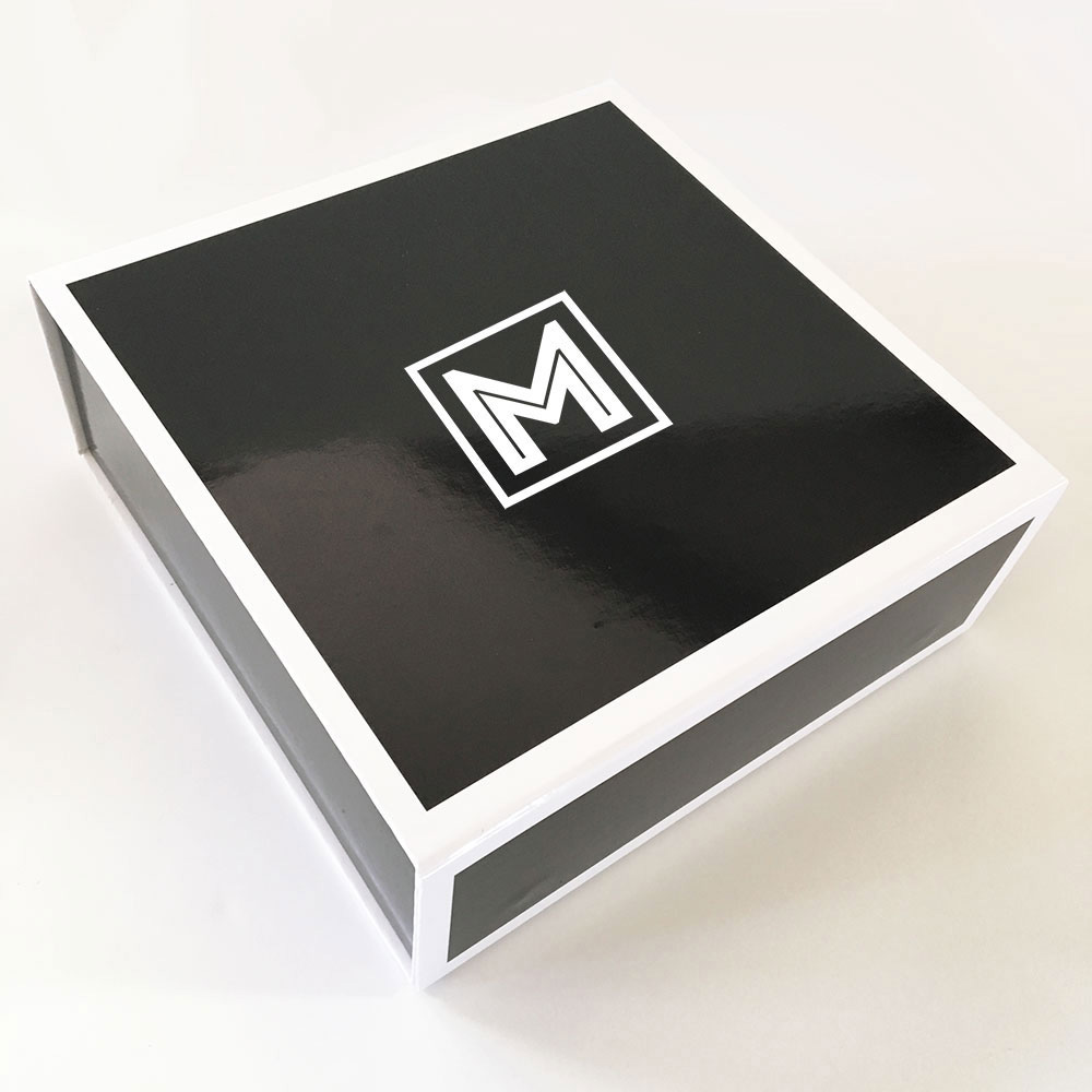 Personalized wedding party gift boxes for your wedding party are individually printed with the first initial of your groomsman, best man, ring bearer, and groom for an unforgettable way to package bridal party gifts.