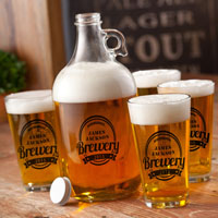 Clear glass growler and pint glasses personalized with black custom printing
