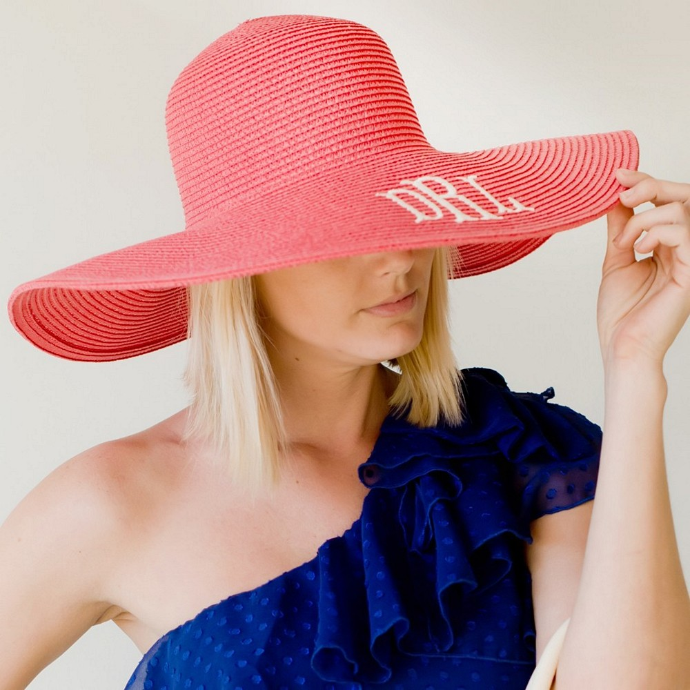Woman wearing Coral color floppy hat personalized with monogram