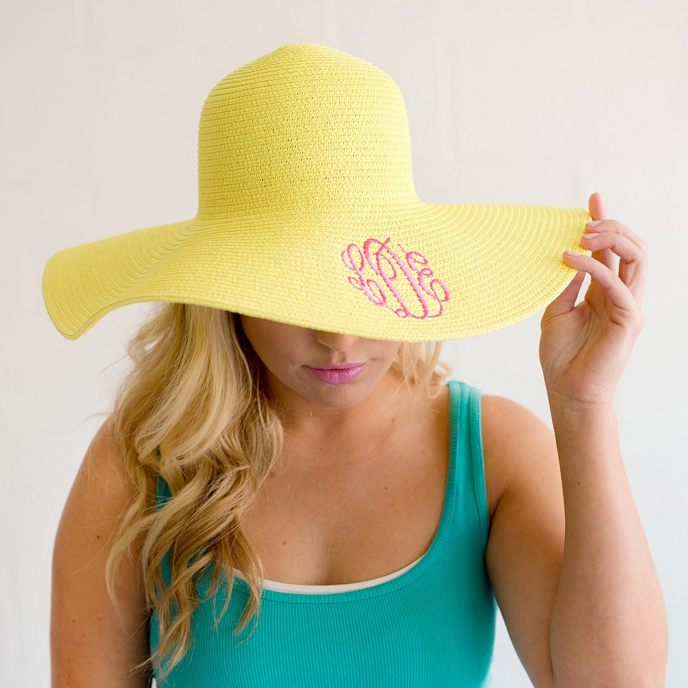 Woman wearing yellow floppy hat personalized with 3 letter monogram