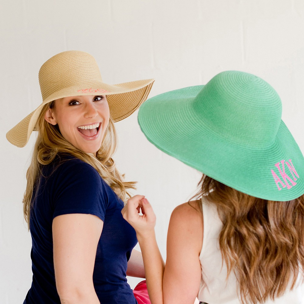 Women wearing natural and mint color floppy hats personalized with monogrammed initials