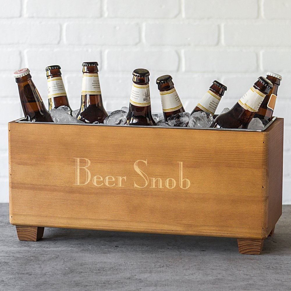 Wood trough beverage chiller engraved with short phrase holding beer bottles
