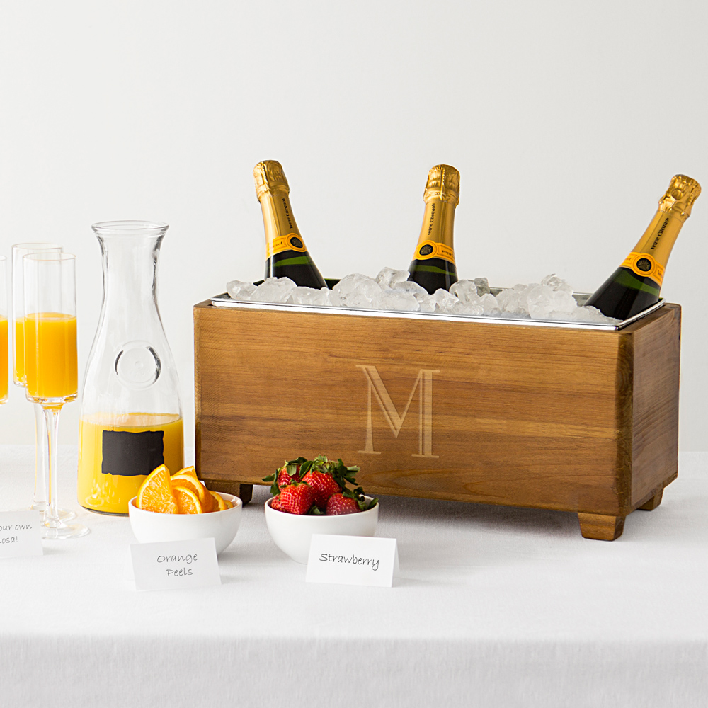 Champagne bottles in wood trough beverage chiller personalized with large single initial