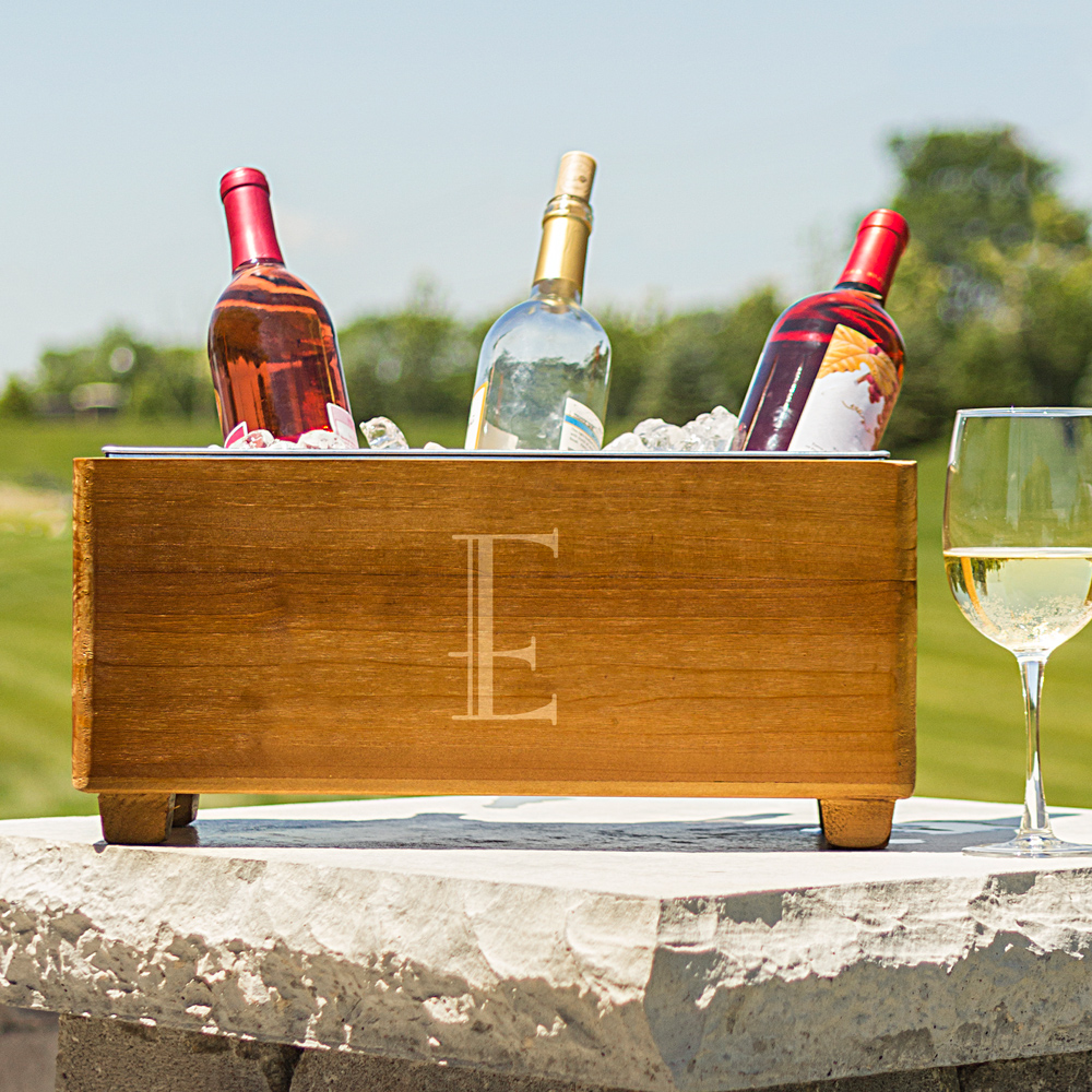 Wine bottles in wood wine trough personalized with large single initial
