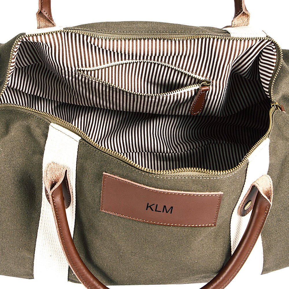 Opened view green canvas and leather duffle bag w/ personalized leather name plate