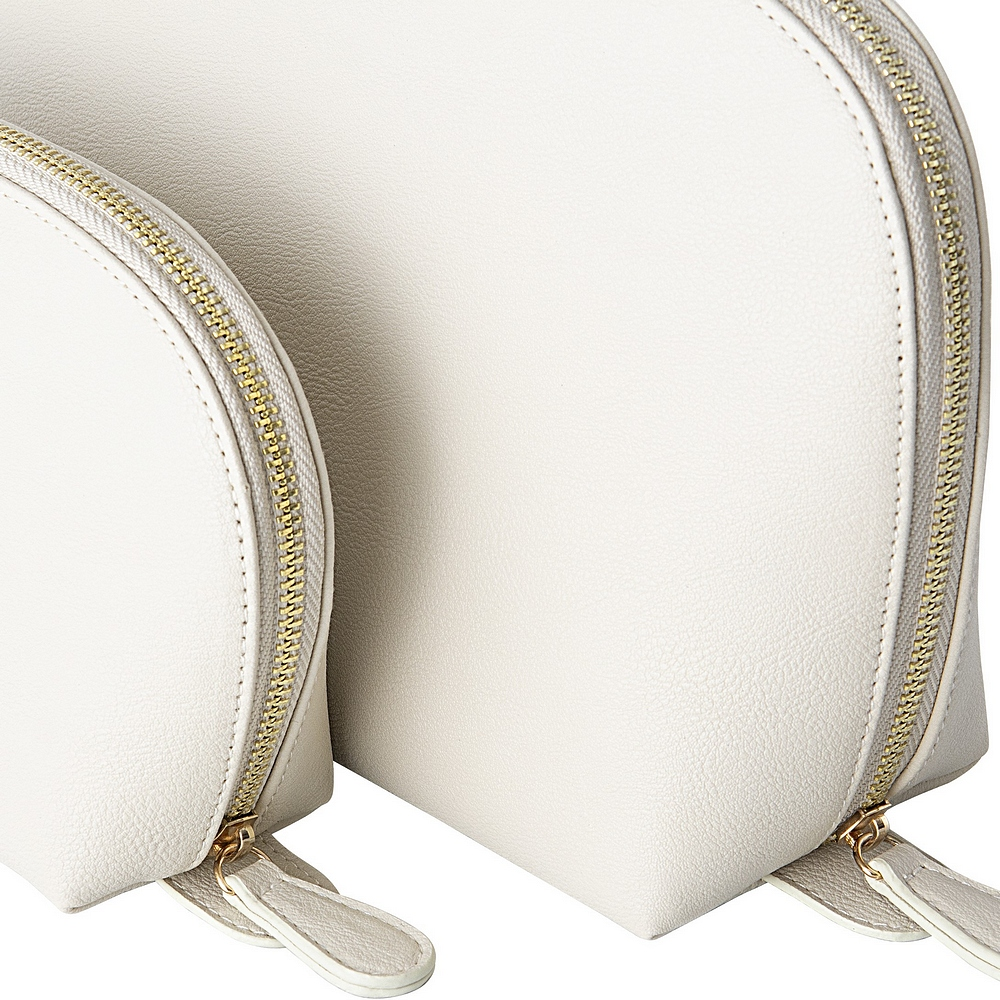 2-Piece cream vegan leather travel case set featuring gold zippers to accent gold polka dots lining on inside