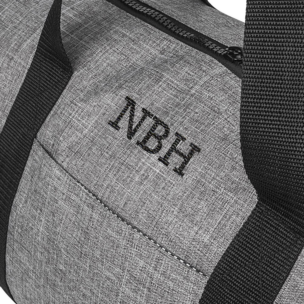 Closeup of initials on personalized men's grey crosshatch duffel bag