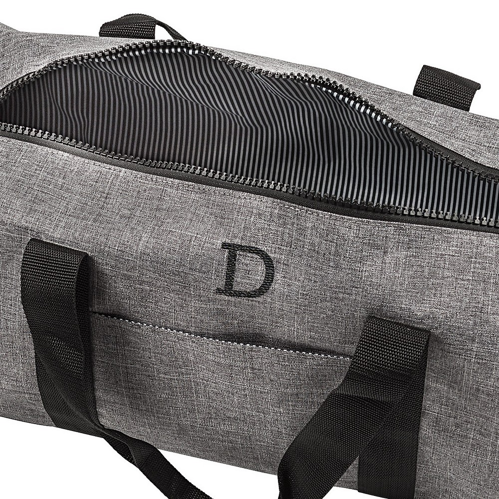 Top open view of men's personalized grey crosshatch duffel bag with black and grey pinstripe interior