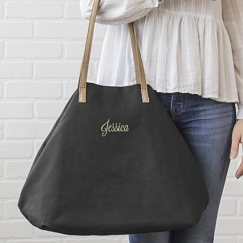Woman holding personalized geometric black canvas overnight bag