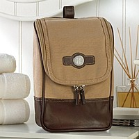 Luxury mens canvas and leather travel toiletry kit bag personalized with monogrammed medallion