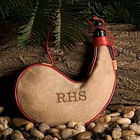 Personalized soft sueded camel-color leather with contrast piping and a rope-style carrying cord
