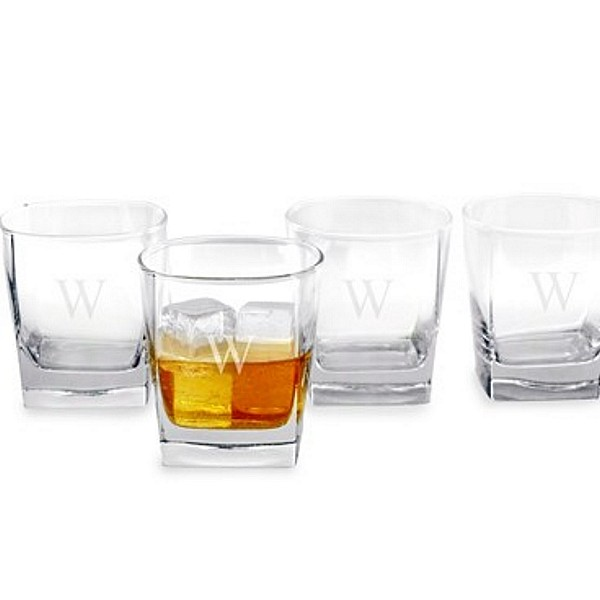 Four rocks glasses engraved with single initial