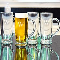 Four craft beer mugs engraved with single initial