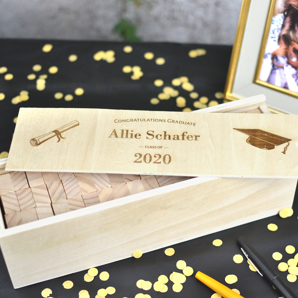 57 Wood blocks stored into the personalized wood keepsake box of the Building Memories graduation guest book alternative
