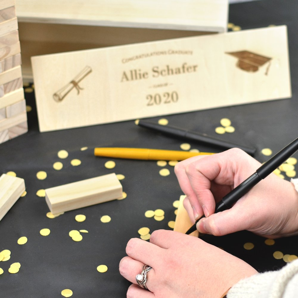 Guests will love signing one of the wood blocks on your graduate's Building Memories wood stacking blocks game graduation guest book alternative