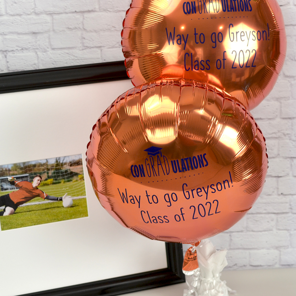 Mylar Graduation Balloon in Metallic Orange with Royal Blue Imprint, design G1215 - Congradulations and two lines of text in Quick Lettering Style.
