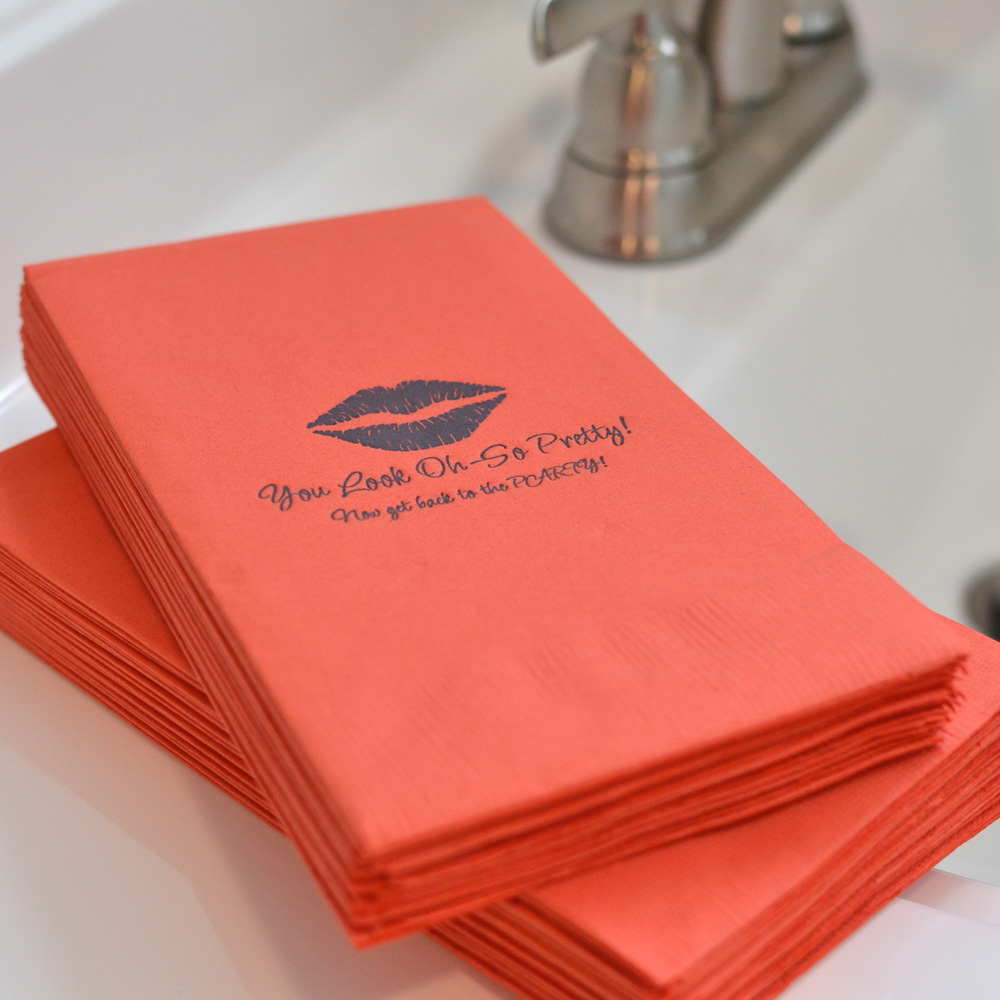 Personalized disposable coral guest towel with 1229 design and two lines of custom print in Flirty lettering style and Dark Grey imprint.
