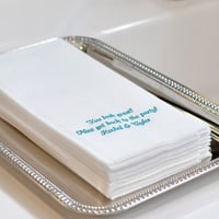 Custom printed white fine linen like disposable guest towels with three lines of print in Cheltenham lettering style