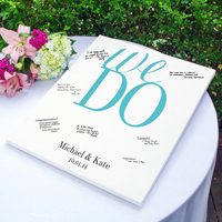 Wedding guest signature canvas featuring 'we do' design and personalized with home names and date