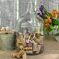 Mr. and Mrs. glass gallon jug etched with married name initial, filled with guest signature wine corks