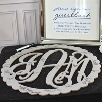 Wood monogram guest book alternative painted grey and shown with signatures from wedding guests