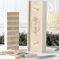 Build love with the help of family and friends, one piece at a time with the Build Love wood stacking blocks wedding guest book alternative complete with personalized floral design decorated wooden storage case