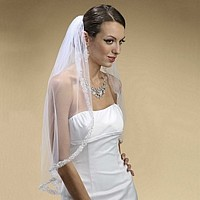 White, embroidered lace and rhinestone edged mantilla veil