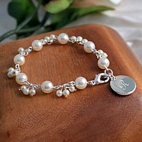 Multi-sized ivory pearl bracelet with engraved silver charm