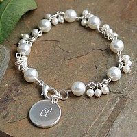 Multi-sized white pearl bracelet with engraved silver charm