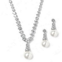 Graduated cubic zironia crystal necklace with white pearl drop and matching earrings