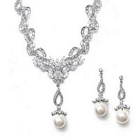 Cubic Zirconia inlaid ribbon design necklace with pearl dangle and matching earrings