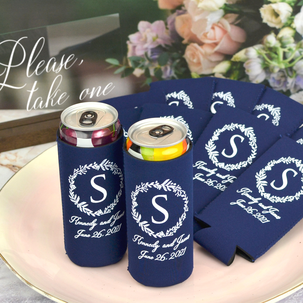 Navy slim collapsable neoprene can coolers personalized with White imprint color and Darlian Script lettering style with wedding wreath design around large block last name initial