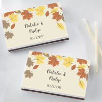 White matchboxes personalized with three lines custom print on stickers with autumn leaf print in golden yellow, brown, and orange