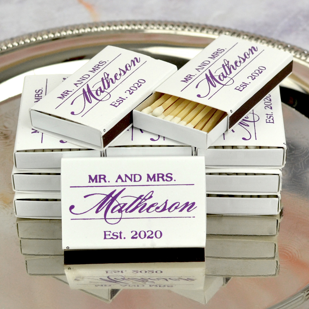 White Matchboxes shown with Purple Imprint, Monogram M-55 and one line of text printed in Strong Lettering Style.