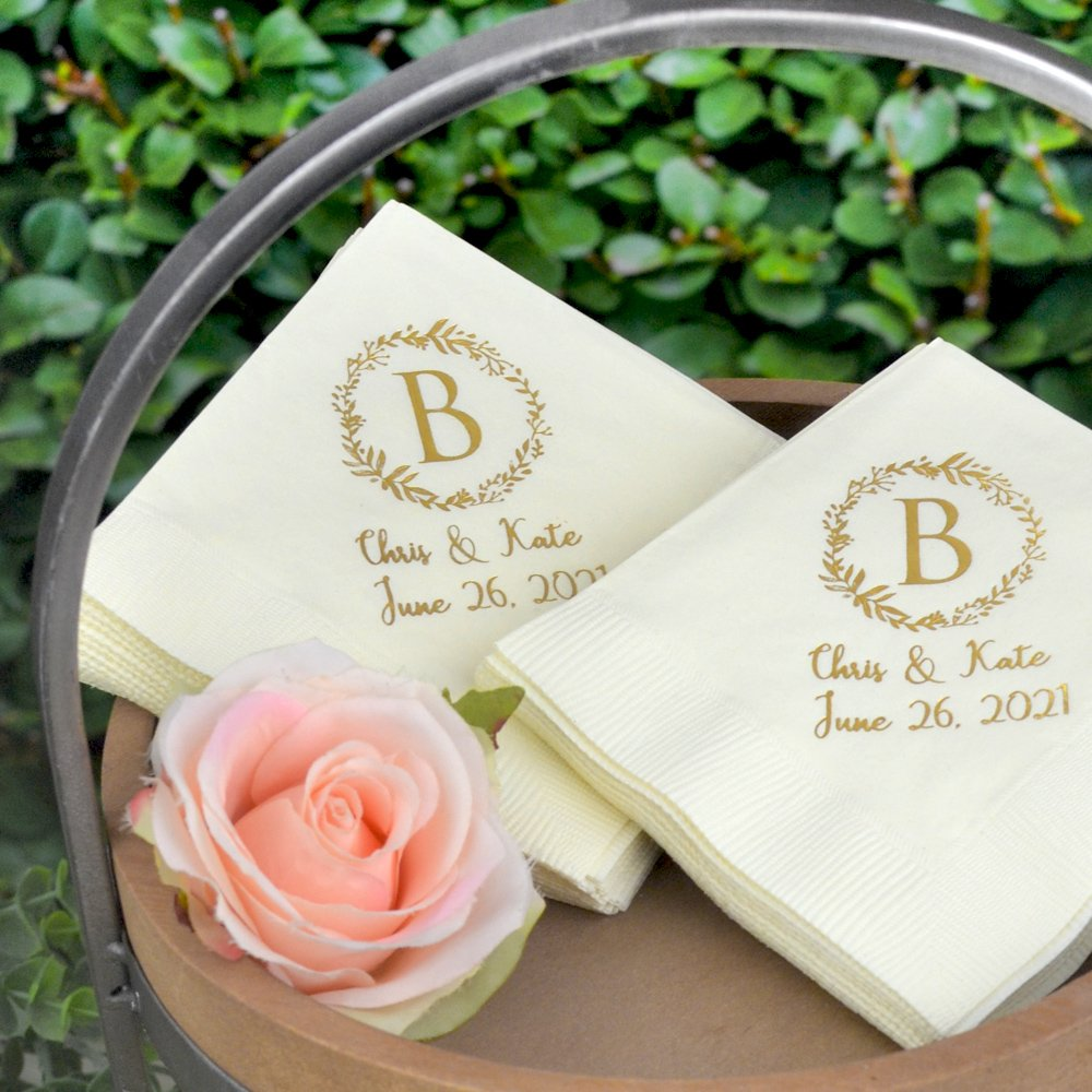Wedding cocktail napkins personlized with wreath design, large block initial, and 2 lines of custom print. See what your wedding napkins will look like with free instant online proofing