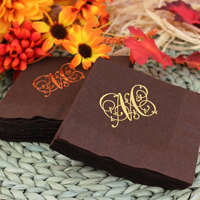 Chocolate brown cocktail napkins personalized with 85-S monogram style in Metallic Gold and Metallic Copper imprint colors